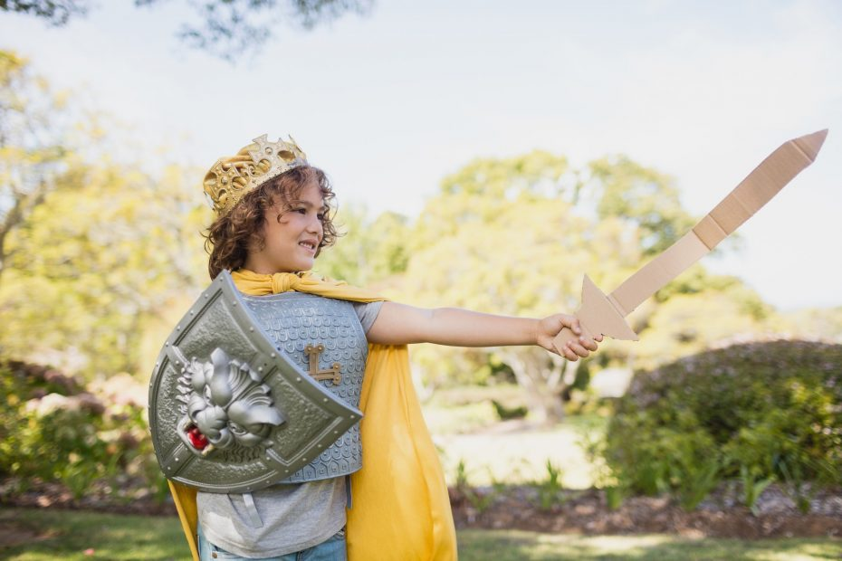 Profile view of boy dressing up in knight